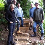 Volunteers standing in front of newly created steps.