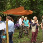 Volunteers and the public discussing the woodland