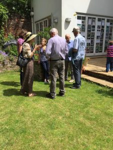 Several woodland members enjoying the sun and refreshments in Tim Barnes' garden