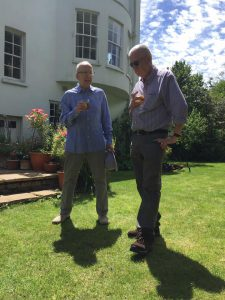 Clive Corlett and Geoff Brighty enjoying a drink in Tim Barnes' garden
